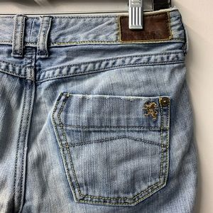 Express faded denim jeans with side zipper ankle